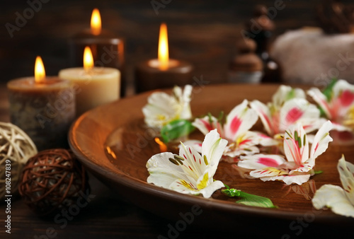 Spa wooden bowl with water and flowers closeup © Africa Studio