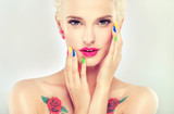 colorful makeup and manicure nails . Stylish blonde girl with bright makeup and colorful nail Polish on your nails . Spring and summer look  and  Earrings beads 108355202,Cupcakes on a plate