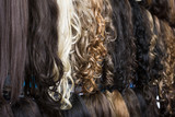 Clip-in hair extensions in wig shop .
