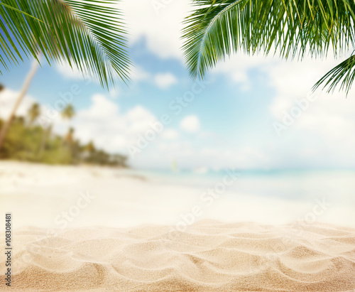 Fototapeta Summer sandy beach with blur ocean on background