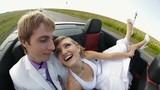 Happy newlyweds in a car