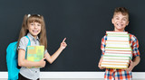 Back to school concept - girl and boy with books