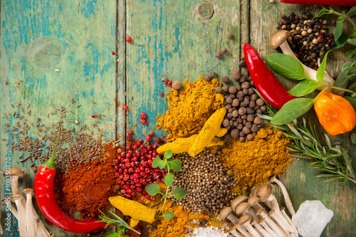 Fototapeta Various colorful spices on wooden table