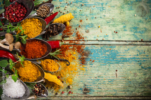 Poster Various colorful spices on wooden table
