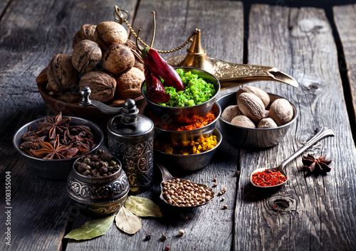 Poster Spices and nuts at wooden table