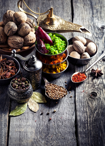Poster Indian Spices at wooden table