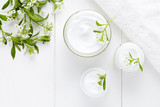 Herbal bodycare cosmetic hygienic cream with flowers skincare product wellness and relaxation medical mask in glass jar on white background - Fine Art prints