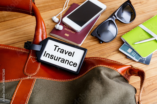 Travel insurance tag on travel bag Poster