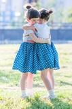 Twins hugging