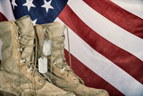Old combat boots and dog tags with American flag - 108415466