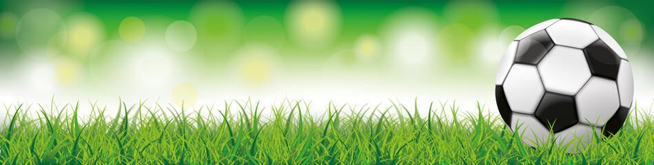 Fußball auf dem Rasen mit Stadionlichtern Header