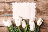 Fototapety Vintage paper card with tulips on wood background