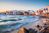 Fototapety Rolling waves and sunset dining at fmaous Mykonos neighborhood of Little Venice, Mykonos, Greece