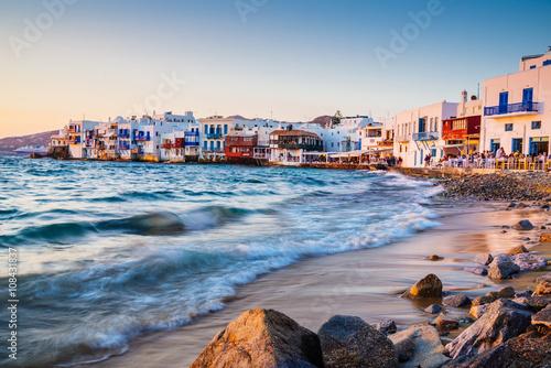 Zdjęcia na płótnie, fototapety na wymiar, obrazy na ścianę : Rolling waves and sunset dining at fmaous Mykonos neighborhood of Little Venice, Mykonos, Greece