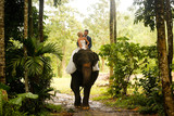 bride and groom riding on a elephant