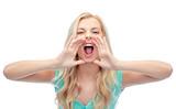 angry young woman or teenage girl shouting