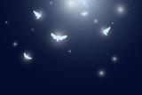 moths flying at night vector