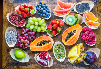 Fruits, berries, nuts, seeds top view.Healthy, detox, superfood.