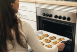 Beautiful woman Preparing Cookies And Muffins.