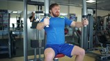 Athletic man doing exercises in a gym