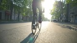man riding a bicycle on the empty road slow motion
