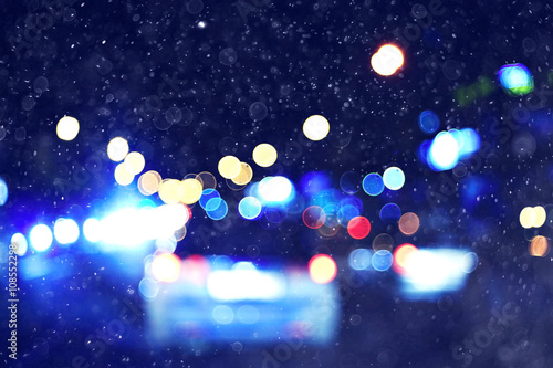 Foto op Aluminium New York TAXI city lights on winter road, blurred background snowfall