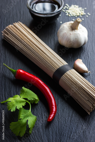 Poster asian food ingredients on black background