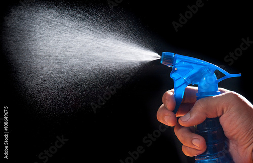 Poster Liquid is sprayed from an atomizer