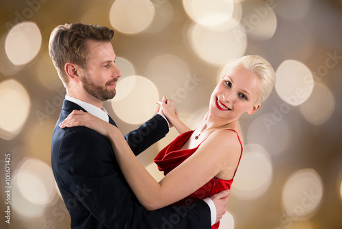 fototapeta na ścianę Young Couple Dancing On Bokeh Background