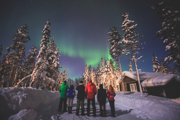 Beautiful picture of massive multicoloured green vibrant Aurora Borealis, Aurora Polaris, also know as Northern Lights in the night sky over winter Lapland landscape, Norway, Scandinavia