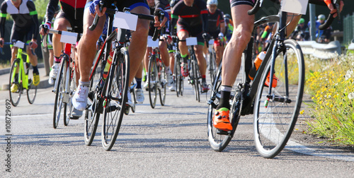 many racing bikes led by trained cyclists