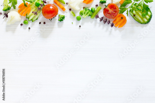 Póster Fresh delicious ingredients for cooking on a wooden background.