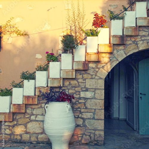 Flower pots on the staircase in old stone house, Crete, Greece