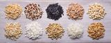 Grains. From left: oats, quinoa, black rice, spelled, barley, brown rice, carnaroli rice, buckwheat, basmati rice, wheat khorasan - 108824489