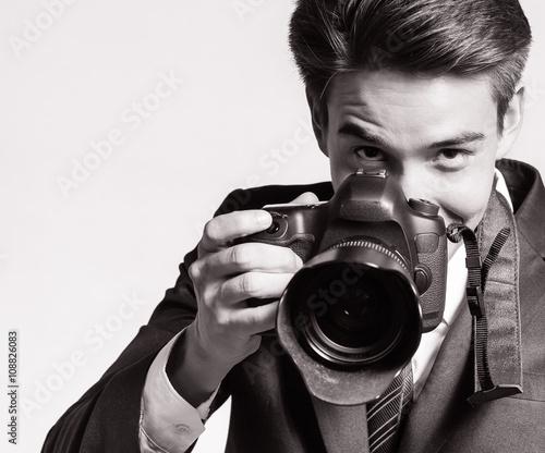 Man using a professional camera. © kieferpix