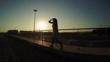 Silhouette of walking girl