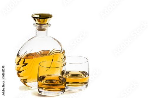 Bottle and two glass of whiskey on white background