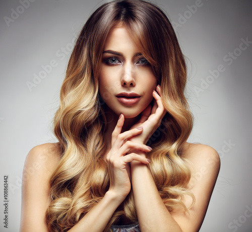 obraz lub plakat Beautiful blonde woman with long, healthy , straight and shiny hair.