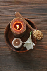 Spa composition with alight candles and beautiful flowers on wooden background © Africa Studio
