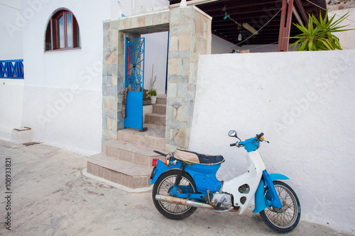 Santorini island with motorcycle on the street in Greece