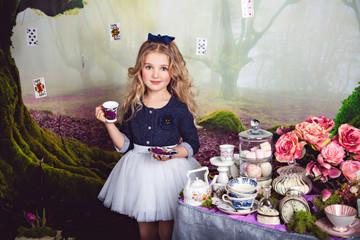 Pretty little girl as Alice in Wonderland
