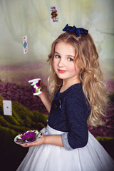 Little girl as Alice in Wonderland