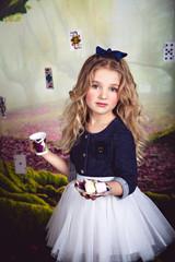 Portrait of pretty little girl as Alice in Wonderland