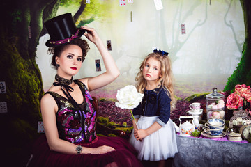 Evil Queen and Alice holding white rose