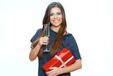 Beautiful woman hold red gift box and wine glass