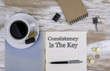 Consistency is The Key - Copybook on the desktop. - 109078279