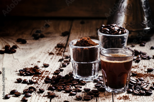 Fotobehang Koffiebonen Black espresso coffee and ingredients for cooking: roasted coffe