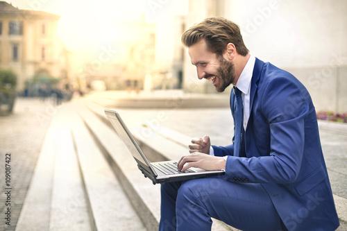 Handsome businessman using a laptop
