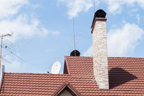 Staande foto Industrial geb. brick chimney on the roof