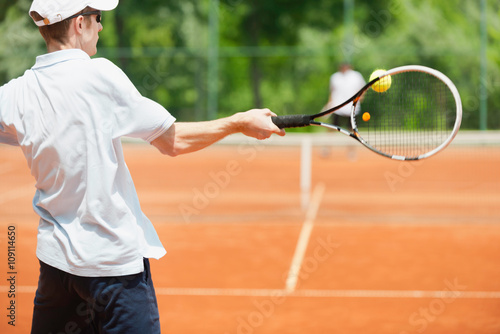 Friends playing tennis, forehand shot Tableau sur Toile